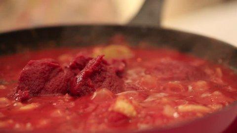 Macro shots of a pot of pasta sauce.