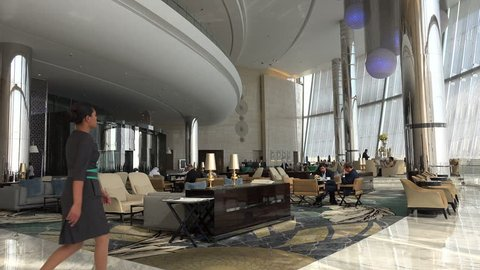 ABU DHABI, UAE - 21 JANUARY 2015: Overview of a hotel lobby and restaurant inside one of the Etihad Towers buildings in Abu Dhabi.