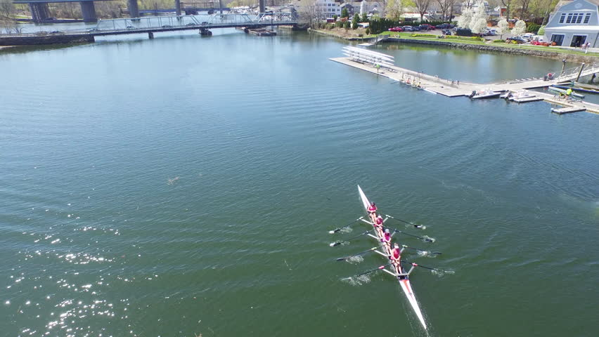WESTPORT, CT/USA - MAY 2, 2015: Aerial competitive rowing. Shot with DJI PHANTOM in 4K UHD. Saugatuck River.