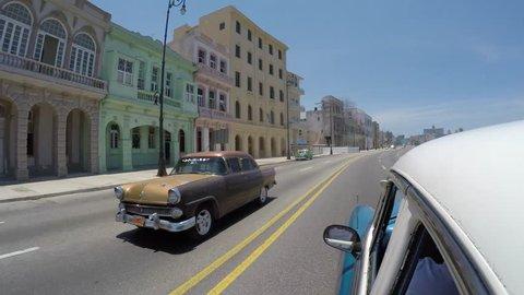 Driving in the famous Malecon Avenue, Havana, Cuba