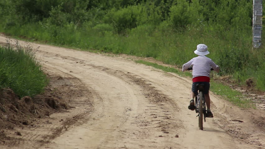 Malawi November 2016 Man Riding A Bike On A Dirt Road Stock