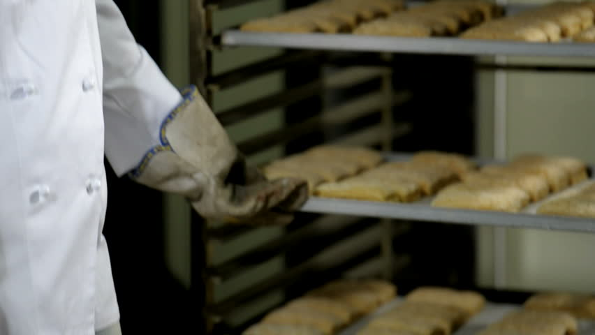 Portrait of a female baker at work; HD Photo JPEG