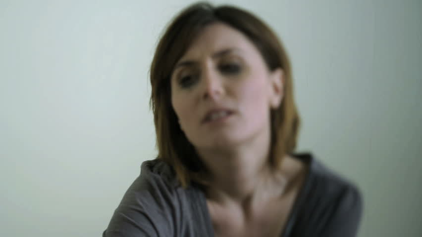Sad/Despairing Woman, maybe victim of violence;  HD Photo JPEG