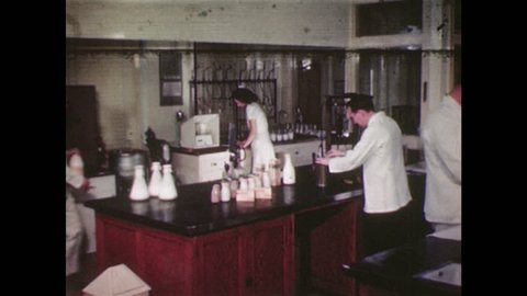 UNITED STATES 1940's – Scientists testing milk in a laboratory.