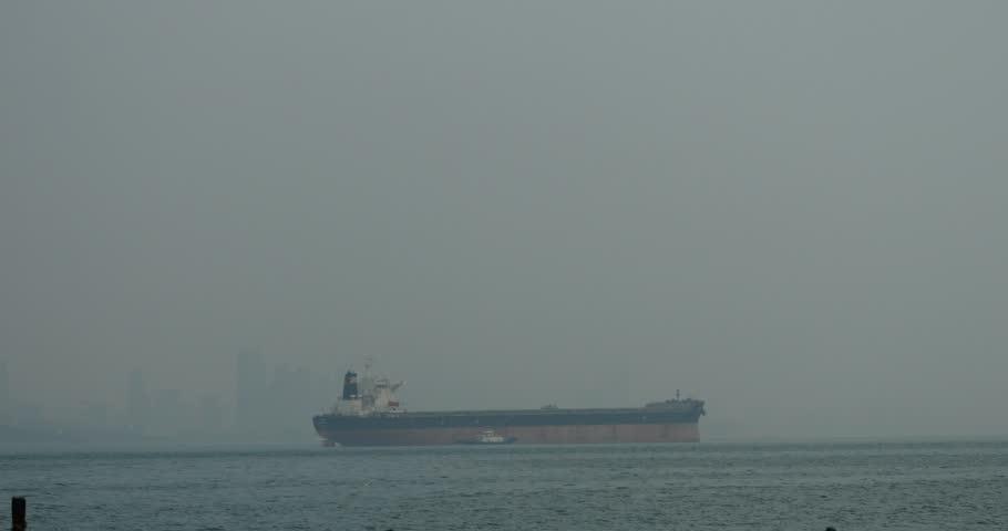 May 10, 2015:4k Huge container oil tanker ship on ocean,modern building background. gh2_10960_4k