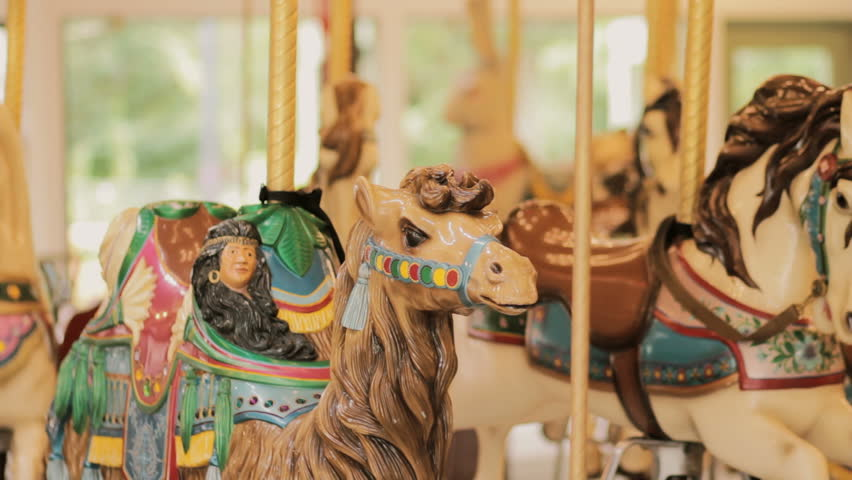 Old fashioned carousel horses, merry go round spinning amusement ride | Shutterstock HD Video #10980245