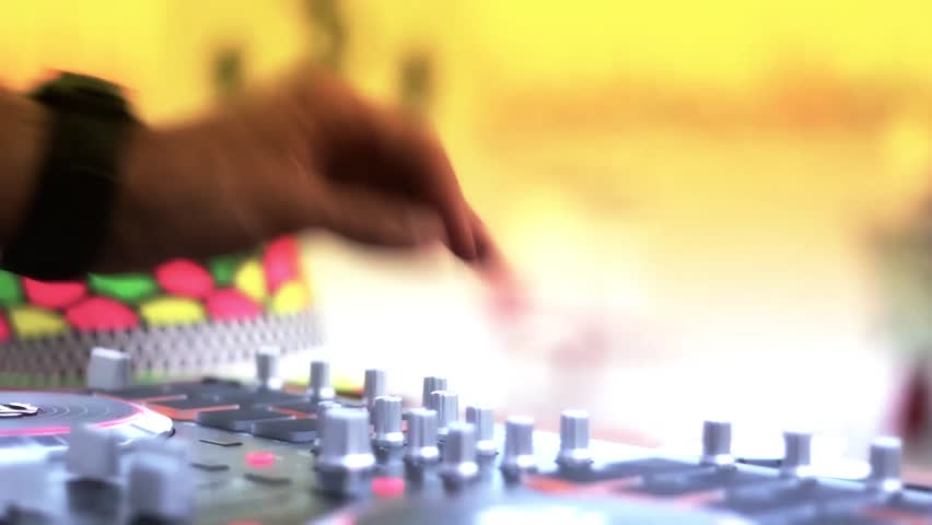 dj play with his stuff at the beach during the party - lifestyle concept