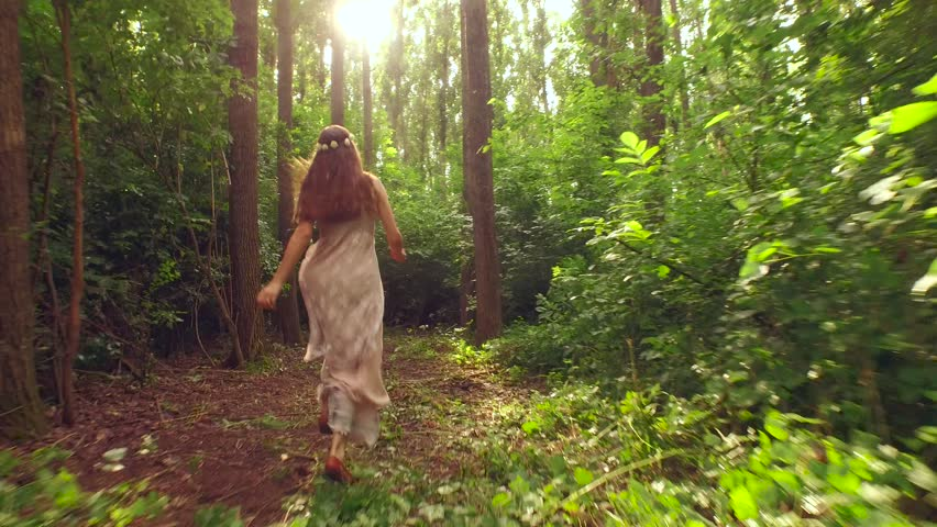 Young Woman Running in Forest Stock Footage Video (100% Royalty-free)  11017595 | Shutterstock