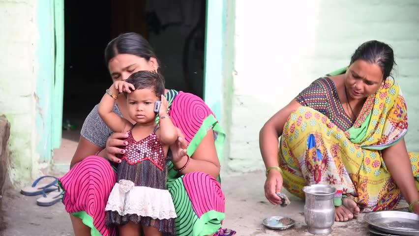 MAHARASHTRA, INDIA July 10, 2015: farm labor women\xD5s daily morning activity, July 10, 2015, rural village Salunkwadi, Ambajogai, Beed, Maharashtra, India