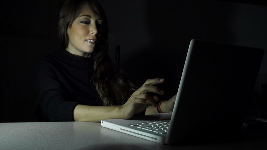 Smiling woman using the computer in the night: having a flirt  | Shutterstock HD Video #11045075