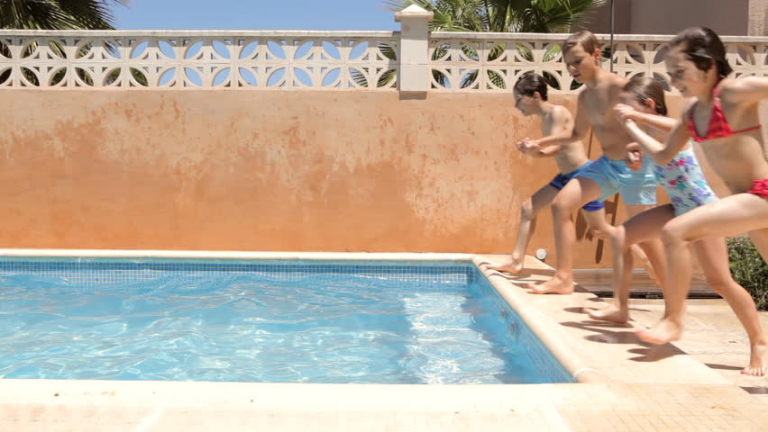 Four children friends playing and jumping into a home for Kids swimming pool garden