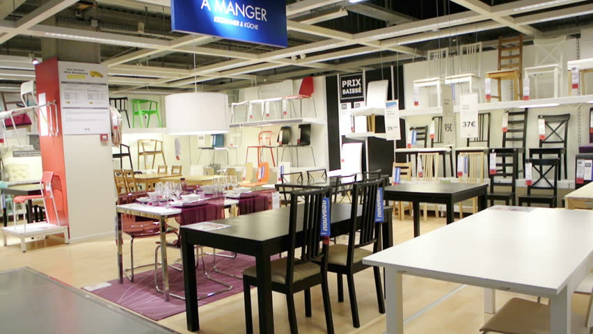 PARIS, FRANCE   CIRCA 2015: IKEA Furniture Store And Customers Browsing  Through Its Furniture, Decoration And Warehouse Goods   Panning Over Chairs  And ...
