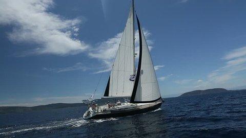 HYDRA-ATHENS, GREECE - CIRCA APRIL 2014: Participants in sailing regatta 11th Ellada Spring 2014 among Greek island group in the Aegean Sea, in Cyclades and Argo-Saronic Gulf.