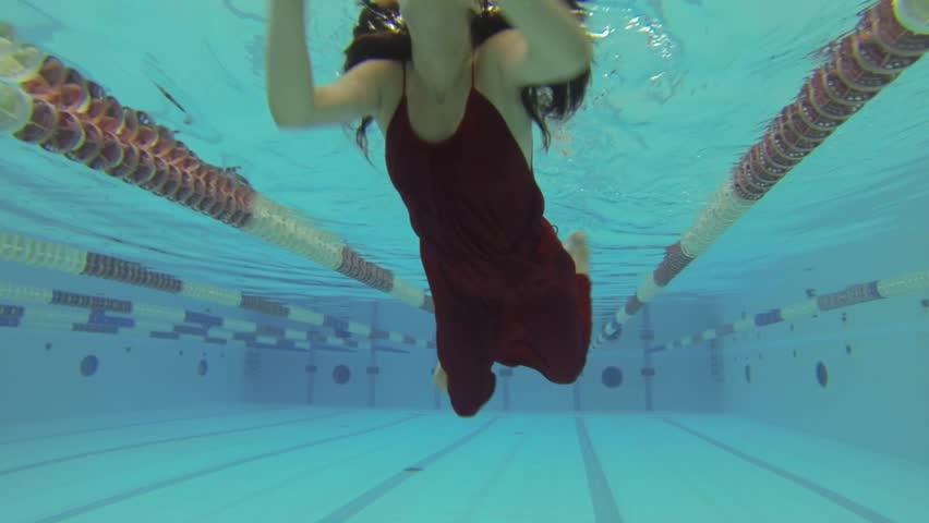 Slow Motion Woman Wearing Red Dress Having Fun Inside Swimming