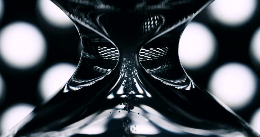 Mask of glass hourglass sand falling 4K