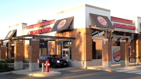 Port Coquitlam, BC, Canada - June 19, 2015 : One side of  Burger King drive thru and front door.  Burger King is a global chain of hamburger fast food restaurants.