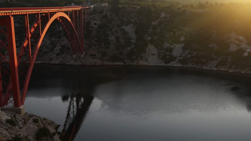 The Maslenica Bridge is a deck arch bridge carrying the D8 state road approximately 1 km to the west of the settlement of Maslenica, Croatia | Shutterstock HD Video #11119985