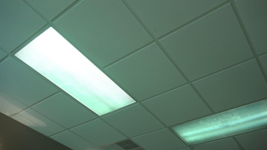 An office fluorescent light turns on then off. | Shutterstock HD Video #11185169