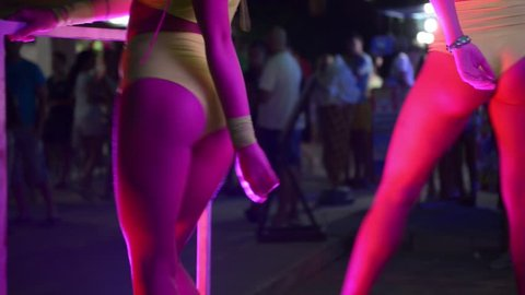 ZHELEZNY PORT, UKRAINE - AUGUST 05, 2015: Girls ass naked go-go dancers PJ in a public place on the night street