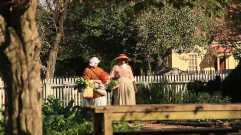VIRGINIA - OCTOBER 2014 - Reenactment, American Revolutionary War era recreation -- Blacksmiths and tradesmen and women working by fire.  Gardens and kitchens in colonial America, williamsburg