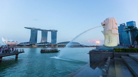 MARINA BAY, SINGAPORE - JULY 30, 2015: Time lapse of the iconic Merlion statue at dusk on July 30, 2015 in Singapore.