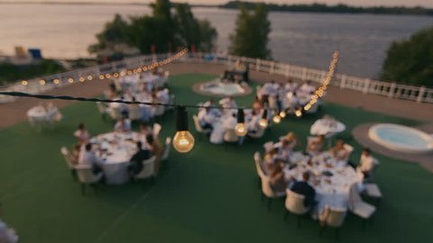Wedding party top view. Stylish open air party near the pool in a picturesque place. No recognizable people