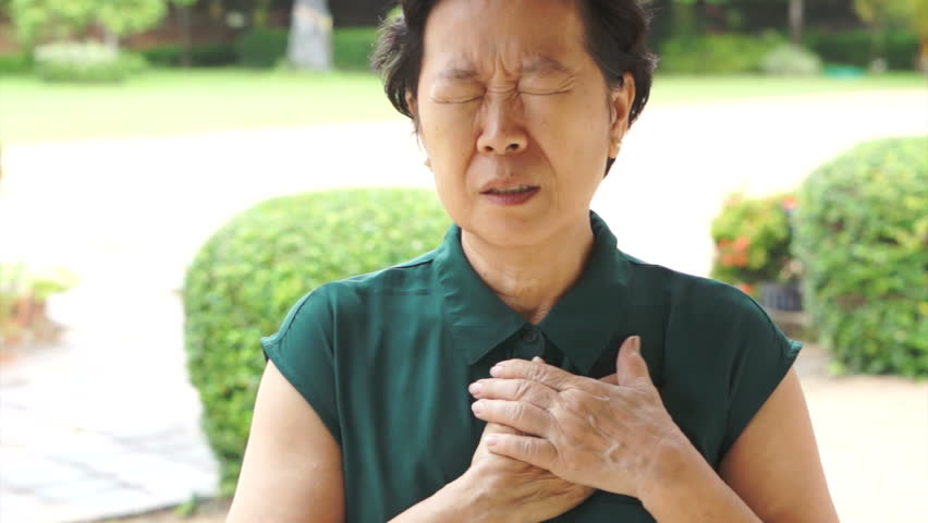 Senior Asian woman having heart attack, chest pain
