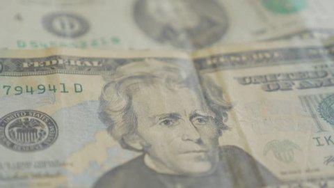 Dollar paper banknotes in a row 4K 2160p 30fps UltraHD tilt footage - Lot of 20 dolar paper bills arranged slow tilting 4K 3840X2160 UHD video