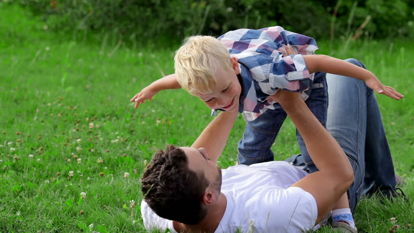 Father and son playing on the grass in park | Shutterstock HD Video #11249435