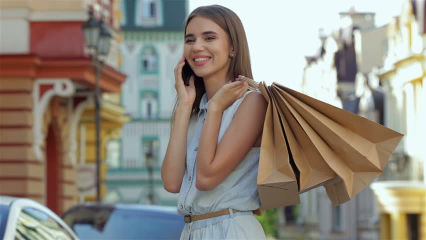 Photo of attractive woman expressing joy of her new purchase, happy good looking girl with shopping bags walking in autumn park, money spending and  antis-tress concept, autumnal sale | Shutterstock HD Video #11278265