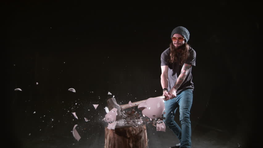 Man smashing piggybank with hammer in slow motion, shot on Phantom Flex 4K at 1000 fps