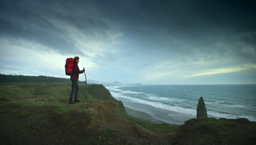 Woman hiking trail on cliffs on the Oregon Coast | Shutterstock HD Video #11303969