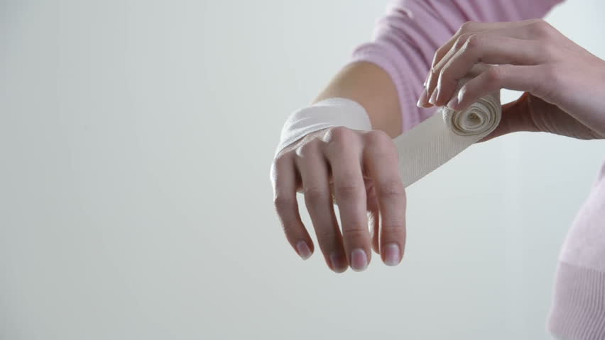 Woman Wrapping Her Hand With Bandage; HD Photo JPEG