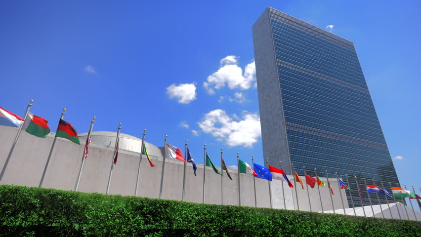 NYC United Nations building, headquarters in New York City and flags of the members countries, panning view  #11461745