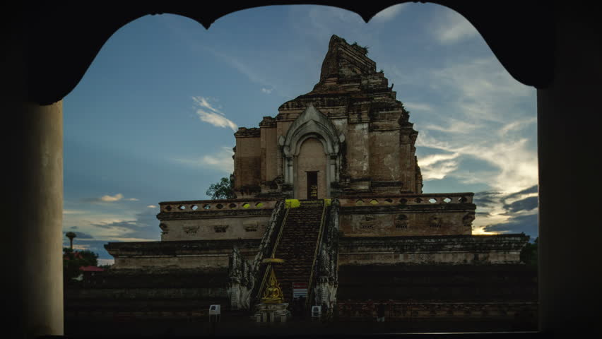 Chedi Luang Pagoda, Sunrise at Wat Chedi Luang Temple with cloudy sky and lens flare - Chiang mai, Thailand