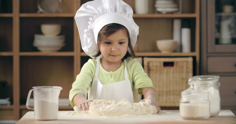 183e20d3397 Adorable Little Girl in Apron Stock Footage Video (100% Royalty-free ...