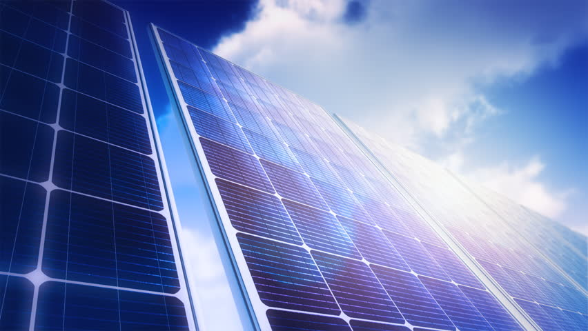 Solar Panels Sky Panorama (Loop). Camera slowly moves across field of solar panels. Clouds timelapse reflects in panels. Soft depth of field and lens flare. Seamless loop. | Shutterstock HD Video #1149115
