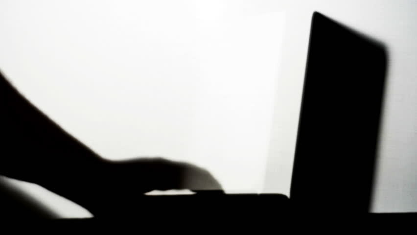 Laptop with Man Typing Silhouette Isolated on White | Shutterstock HD Video #11503475