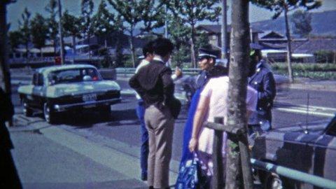 Okayama, JAPAN 1972: Japanese police capture criminals in car accident.