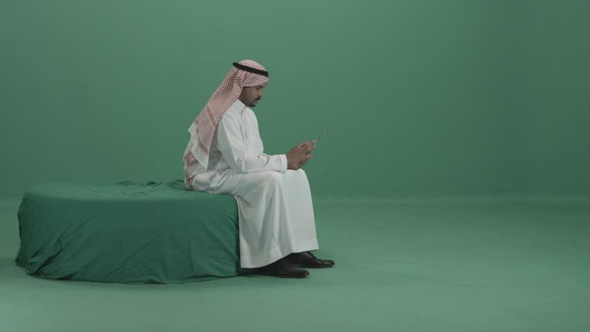 Arabic Adult Male working on Digital Tablet ...