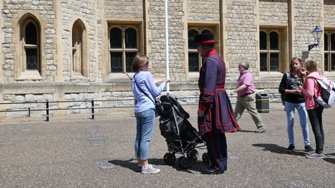 London, United Kingdom - MAY 16, 2015: Yeomen Warders of Tower of London (Beefeaters). Beefeaters are ceremonial guardians of the Tower of London.