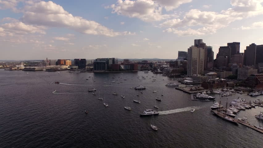 Boston Aerial v37 Flying low over inner Boston Harbor panning right with cityscape views.