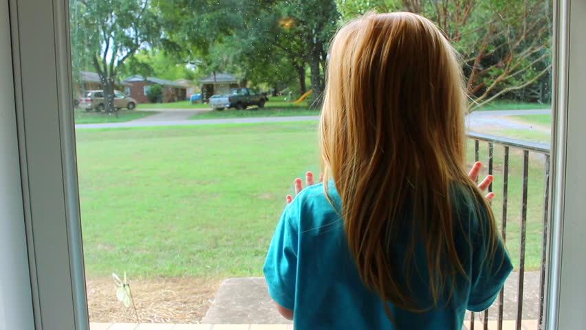 looking out door. a beautiful little red haired girl looking out the front door, waiting for her daddy to get home from work. stock footage video 11567525 | shutterstock door