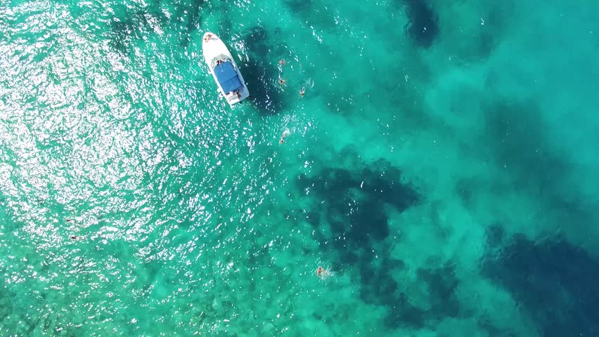 aerial view of boat in the clear water near the beach Zanjica, Montenegro   #11598725