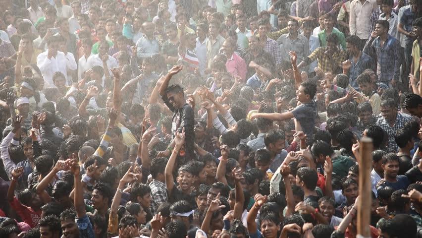 """MUMBAI, MAHARASHTRA, INDIA - SEPTEMBER ?06 - Groups of People """"Govinda"""" enjoying the Dahi Handi festival to celebrate God Krishna's Birth in Mumbai, Maharashtra, India. September ?06, ?2015"""