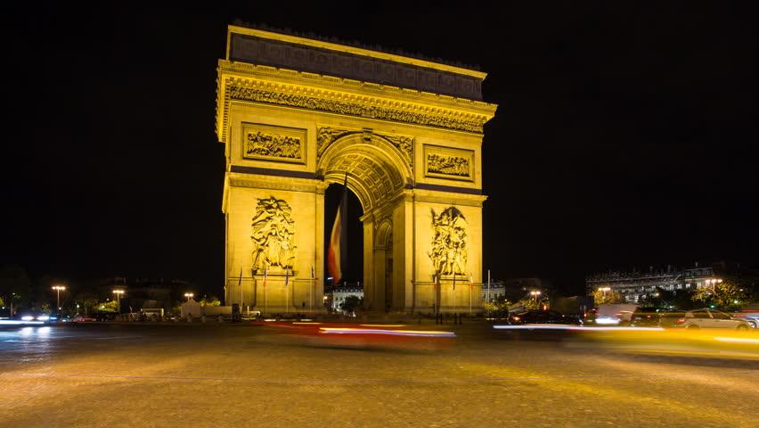 France, Paris, Etoile, French flag under Arc de Triomphe built by Napoleon - timelapse | Shutterstock HD Video #11604755