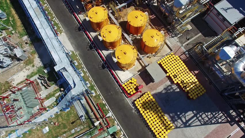 Flights above oil plant in Indonesia. View on yellow oil tanks from top. Was using 4K drone camera
