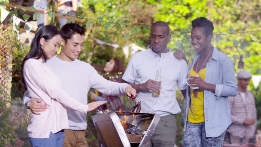 4K Happy Attractive Friends Chatting While They Cook At Bbq Party Shot On RED Epic