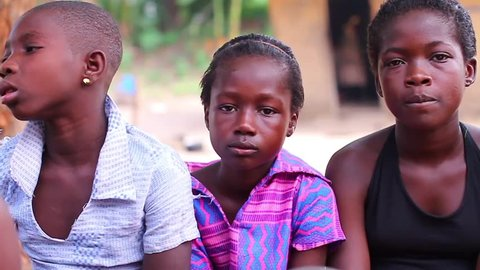Black African children sitting quietly, Akosombo  Ghana, December 2012