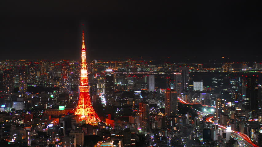 Wide aerial time-lapse shot of Tokyo Tower at night